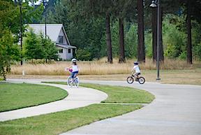 2 kids biking & Fir Grove copy